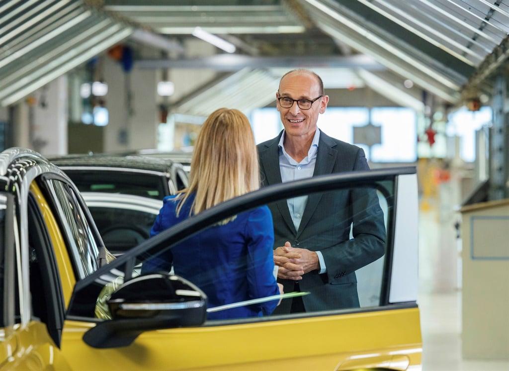 Volkswagen brand CEO Ralf Brandstätter standing n