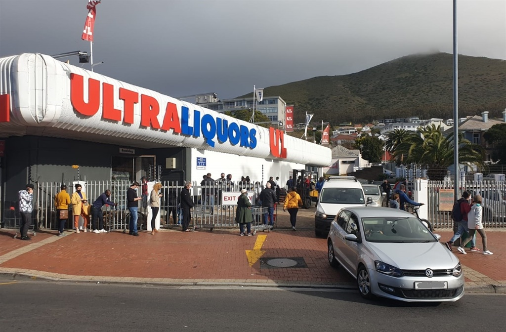Cape Town residents lining-up outside a liquor store in Green Point.