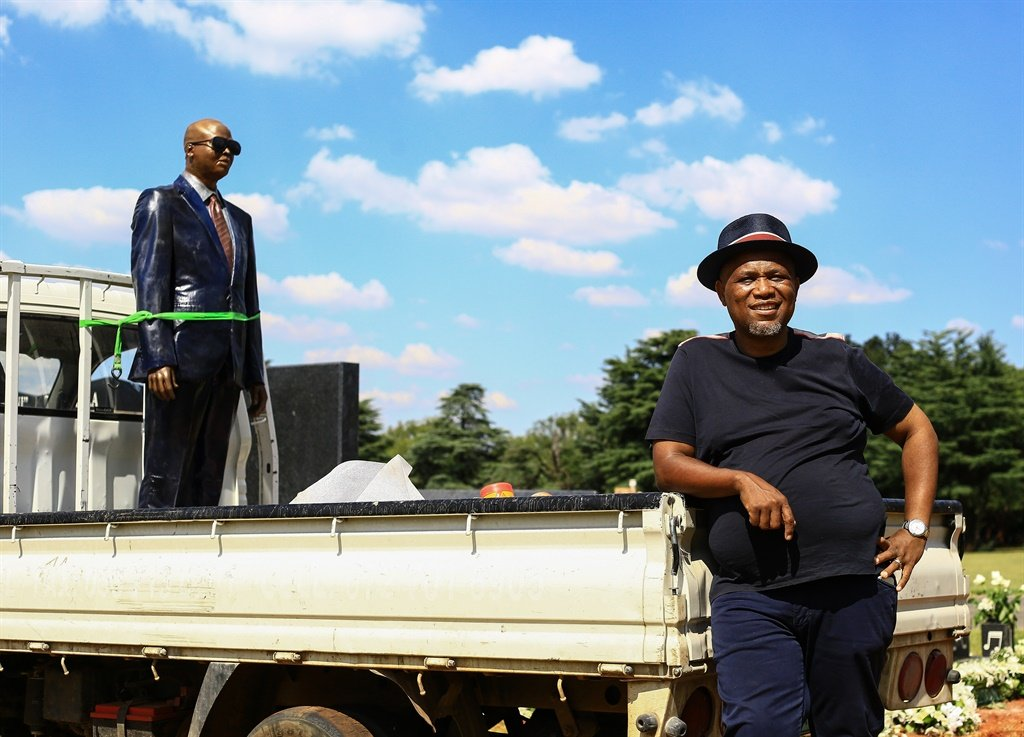 Artist and businessman Lebohang Khitsane is seen next to a truck transporting the statue of the late musician Robbie Malinga at Westpark Cemetery, Johannesburg in January 2018. Malinga's statue was carted away for remodelling after a public and social media uproar that the statue was a poor likeness of the musician. Picture: Gallo Images / Sunday Times / Veli Nhlapo