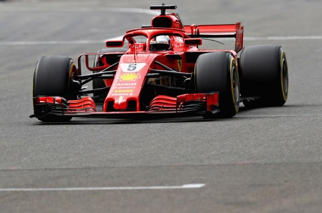 Sebastian Vettel driving his Ferrari to victory at the 2018 Belgian GP (Mark Thompson / Getty Images)