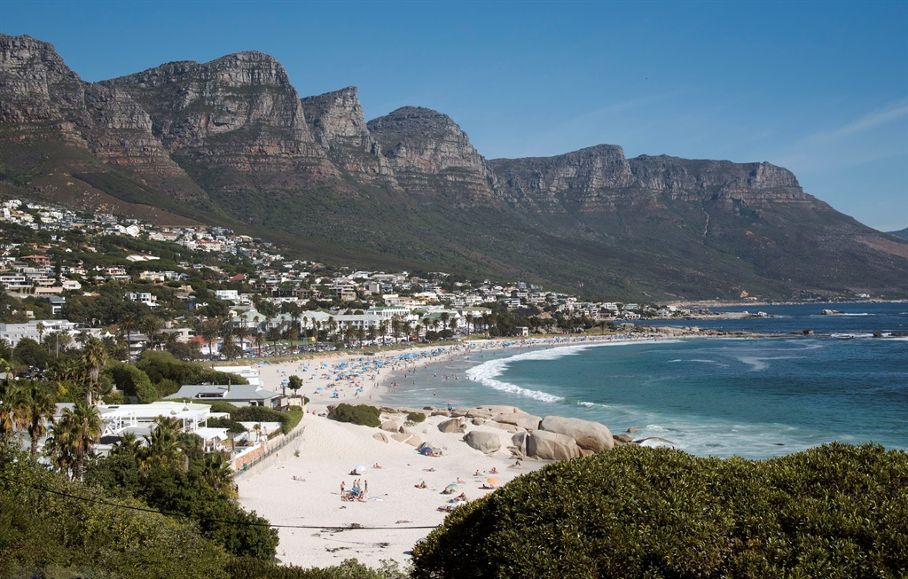 After booking a Camps Bay luxury house for a weekend, an art collective by the name #WeSeeYou has declared an indefinite sit in to address matters around land and housing (Photo by: Education Images/Universal Images Group via Getty Images)