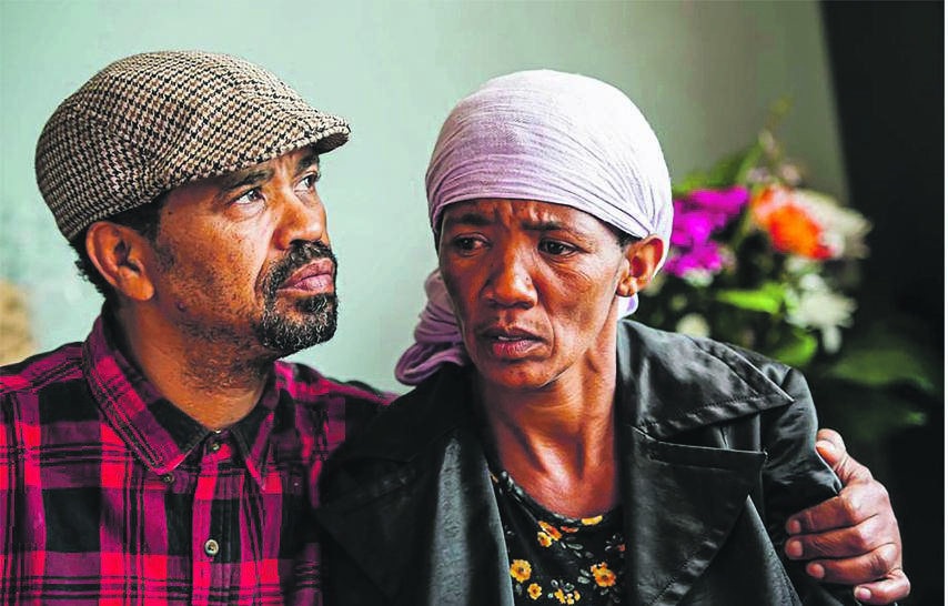 Clint Smith and Bridget Harris, the stepfather and mother of Nathaniel Julies, who was allegedly murdered by police on Wednesday. Picture: Deon Raath