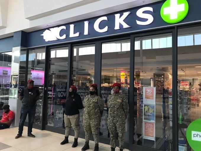 Guards outside a Clicks store in Menlyn Mall, Pretoria.