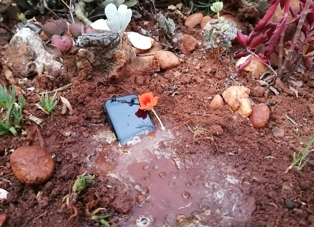 A buried and watered smartphone