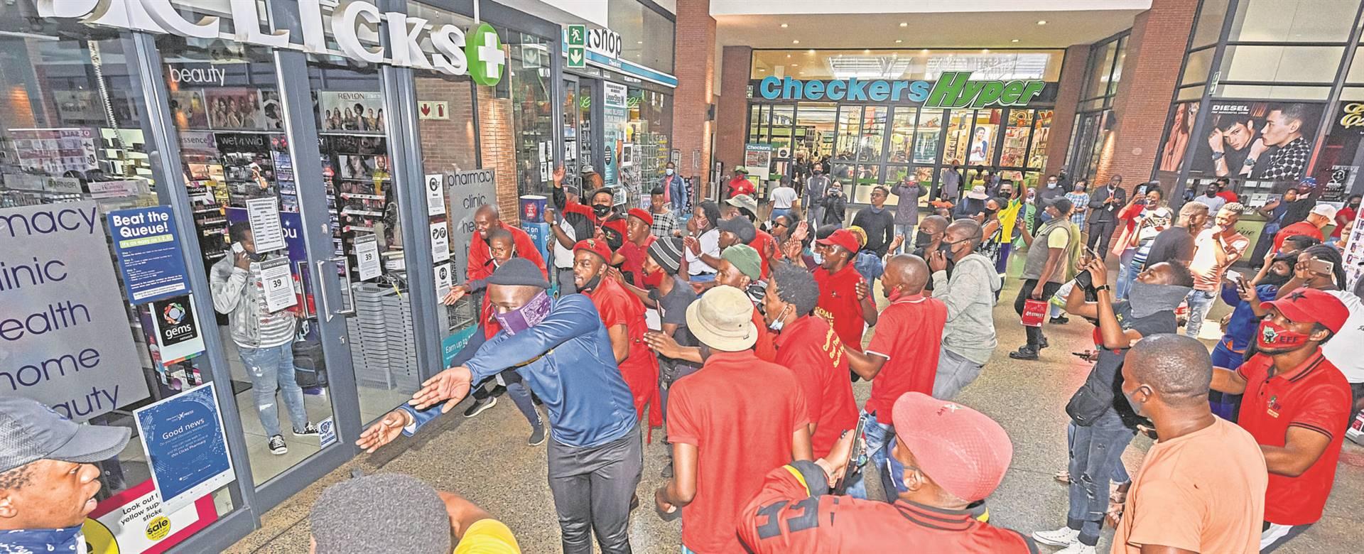 EFF shut down Clicks Stores. BELOW: An EFF crowd arrives at Liberty Midlands Mall. PHOTOS: Moeketsi Mamane