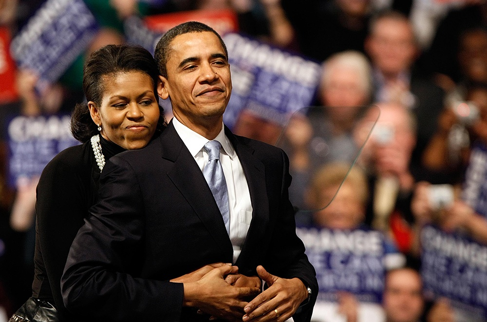 Michelle Obama hugs Barack Obama (D-IL) is hugged by his wife Michelle Obama before his speech at a primary night rally on 8 January 2008. (Photo by Win McNamee/Getty Images)