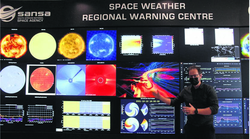 Stefan Loetz, a researcher at Sansa, explains the data displayed on the various monitors in the Space Weather Station.Photo: Bianca Du Plessis