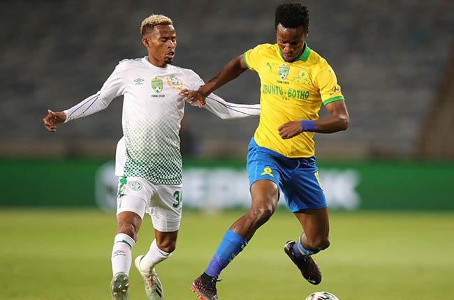 Themba Zwane of Mamelodi Sundowns challenged by Andile Fikizolo of Bloemfontein Celtic.