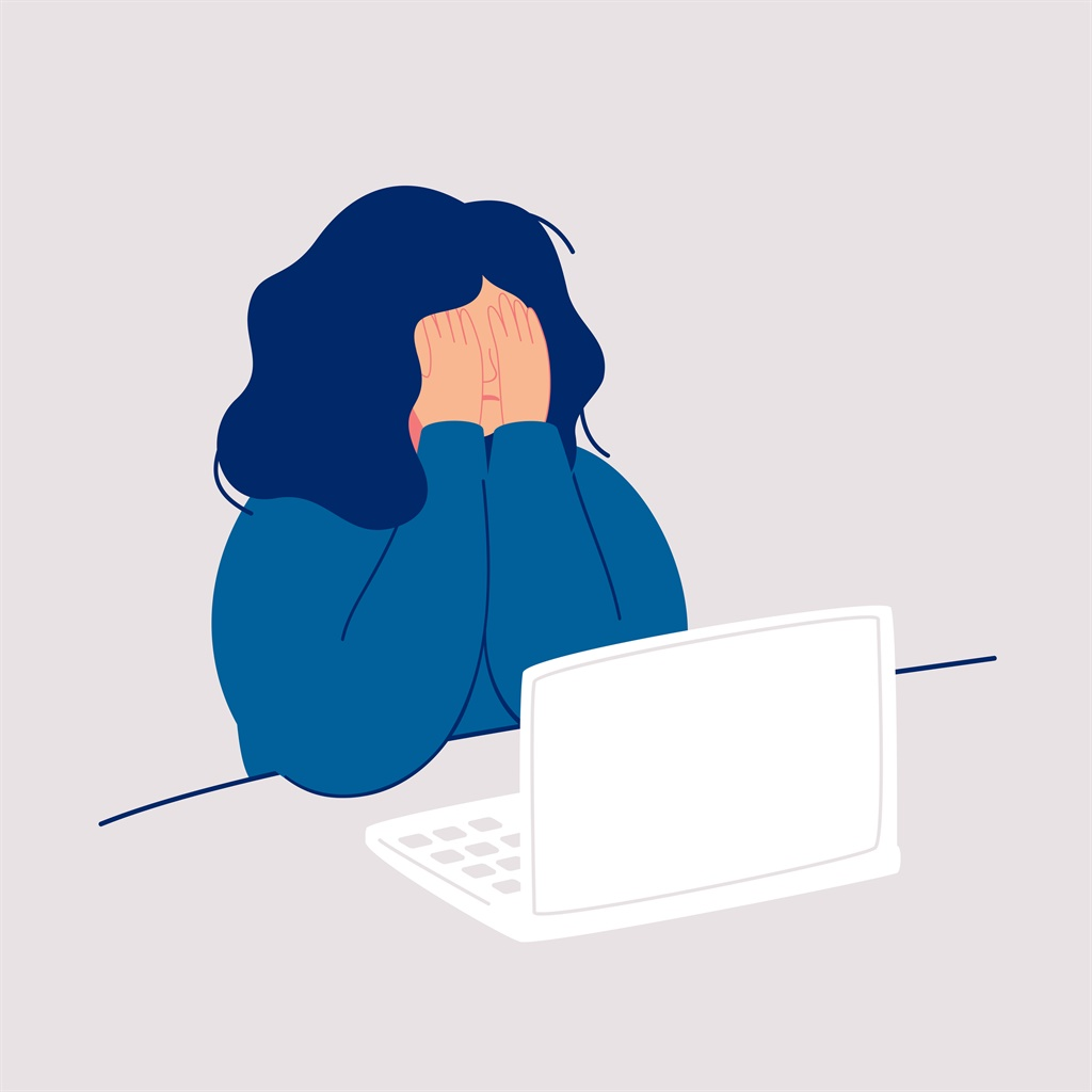 Disheveled woman sits at the computer and crying c