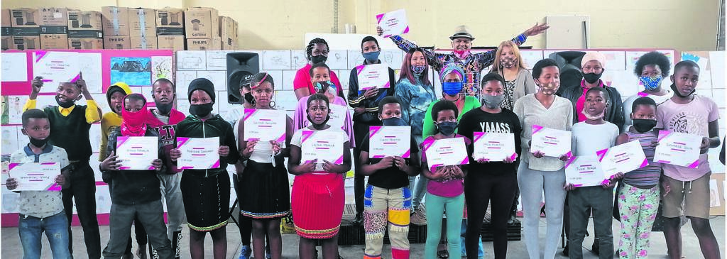 Graduates showcase their certificates. They are joined by their parents and teachers. PHOTO: unathi obose