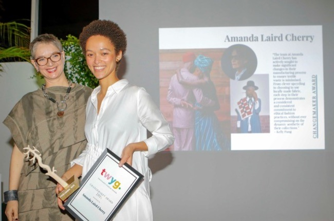 Zwelisha Giampietri accepting the Changemaker Award on Amanda Laird Cherry's behalf. (Image supplied)