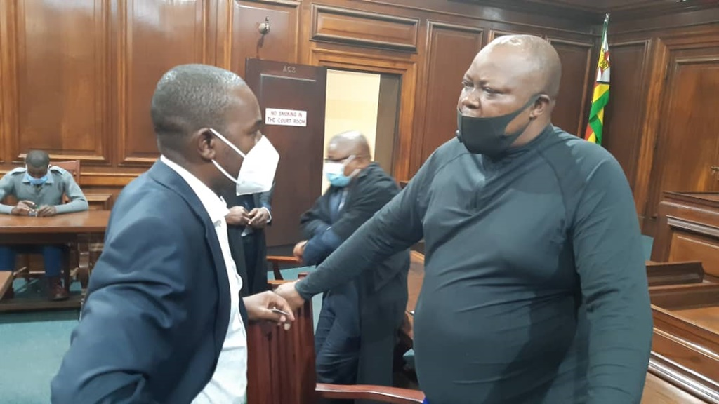 Job Sikhala in court speaking to his attorney.