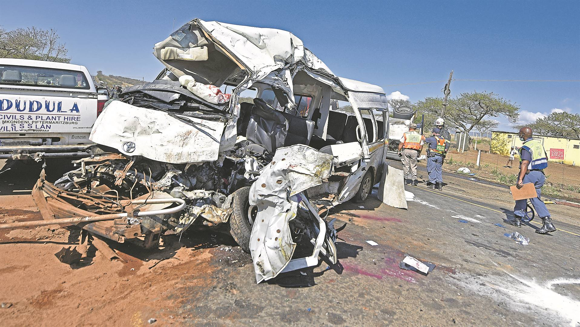 Thirteen people, including an unborn baby, were killed in an accident involving a taxi, a bakkie and a diesel tanker on the R33 near Wartburg yesterday. PHOTO: Moeketsi Mamane