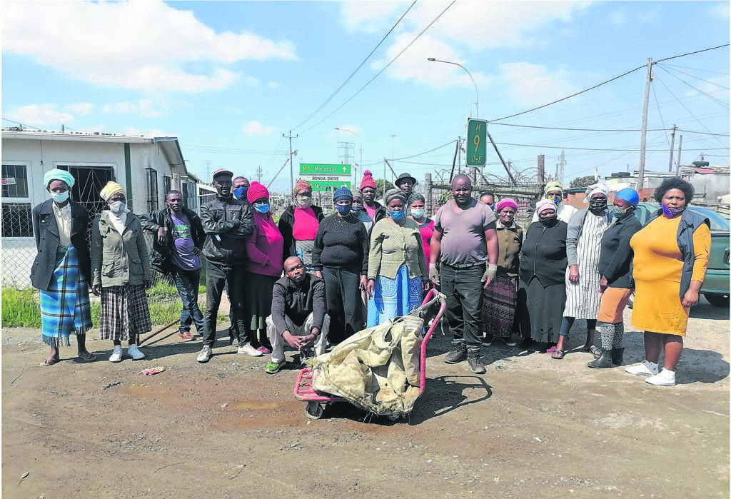 Boost: Scores of waste pickers, a group of people who make a living by collecting recyclable material, recently met to plot ways to formalise their business. They also got a much-needed boost with shipping containers to keep their material and have been asked to work in their respective areas to promote unity and peace. Picture: Unathi Obose