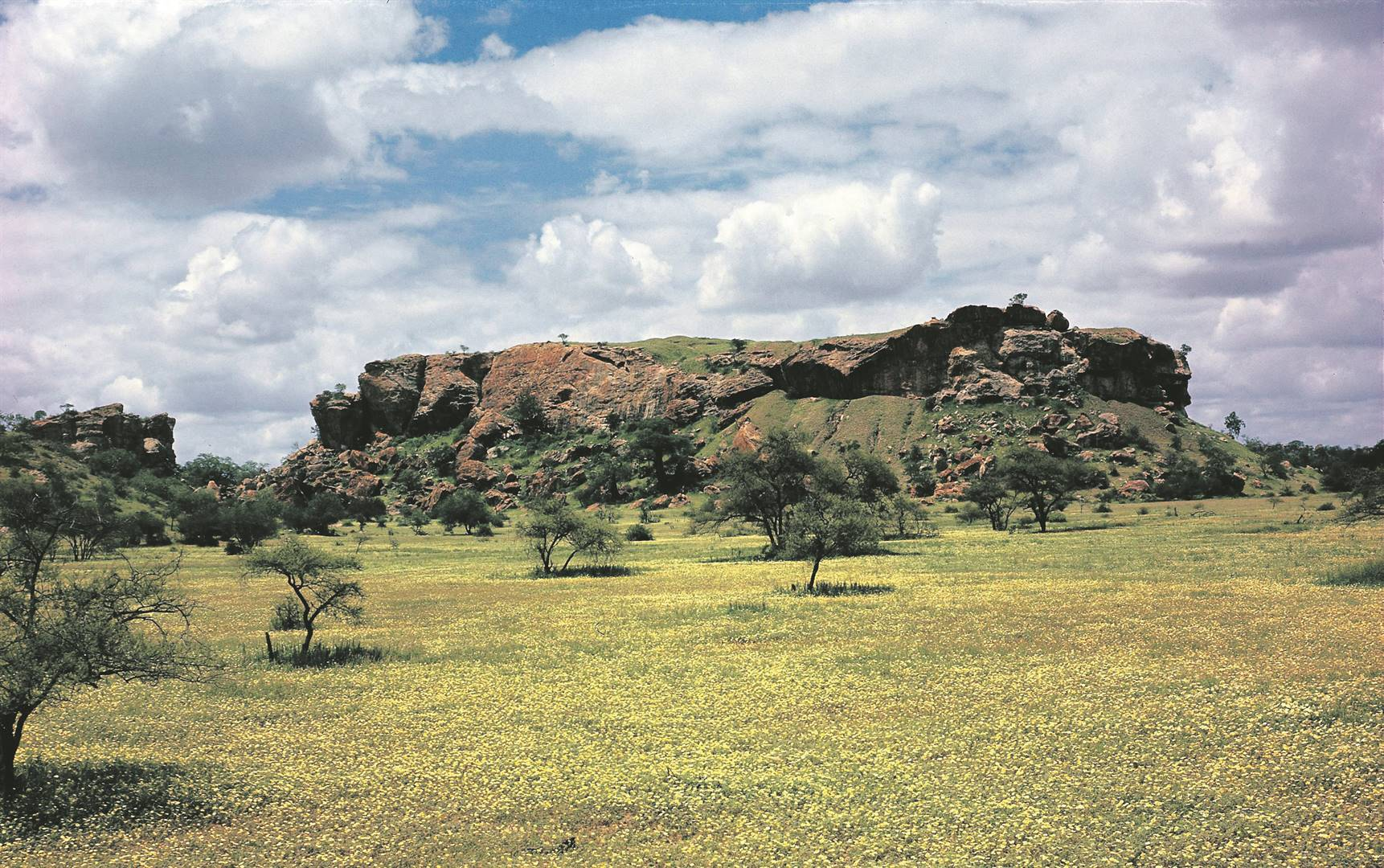 Mapungubwe Hill rises in the countryside.