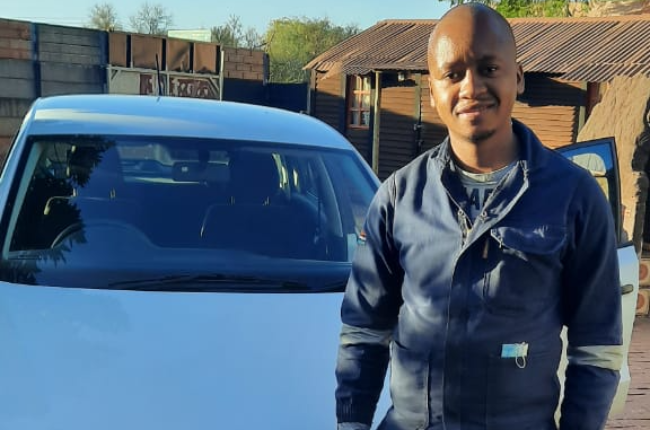 In happier times, Lefa Mabula was all smiles after getting his first car.