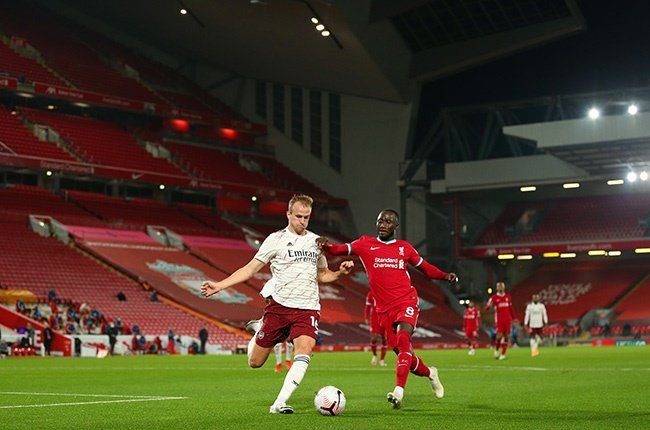 Rob Holding of Arsenal and Naby Keïta of Liverpool during the Premier League match at Anfield on 28 September 2020.
