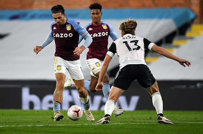 Jack Grealish of Aston Villa is challenged by Tim Ream of Fulham during the Premier League match at Craven Cottage in London on 28 September 2020.