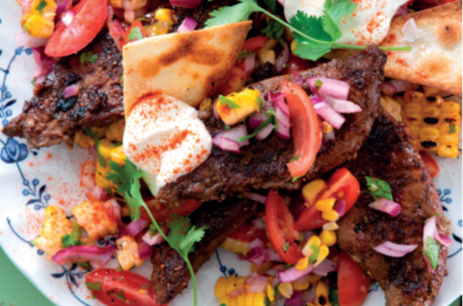 Delicious spicy lamb liver with tomato and corn salad  and sour Cream.