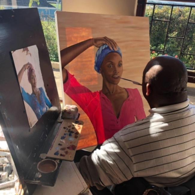 The quadriplegic painter doing what he does best.