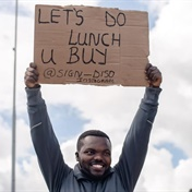 FEEL GOOD | Man who lost job during lockdown turns to funny placards to raise funds