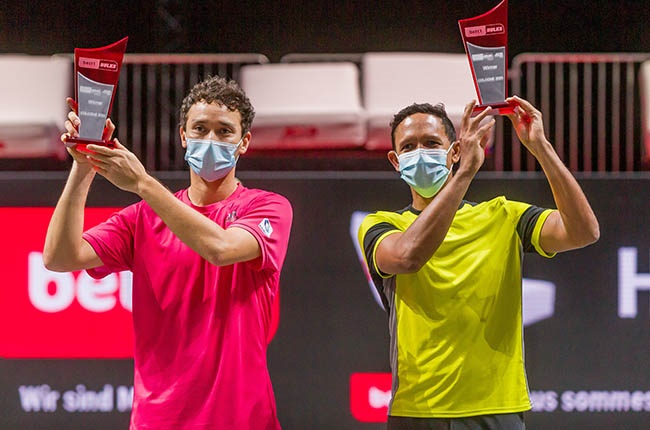 Ben McLachlan and Raven Klaasen celebrate winning the ATP event in Cologne, Germany on 25 October 2020.