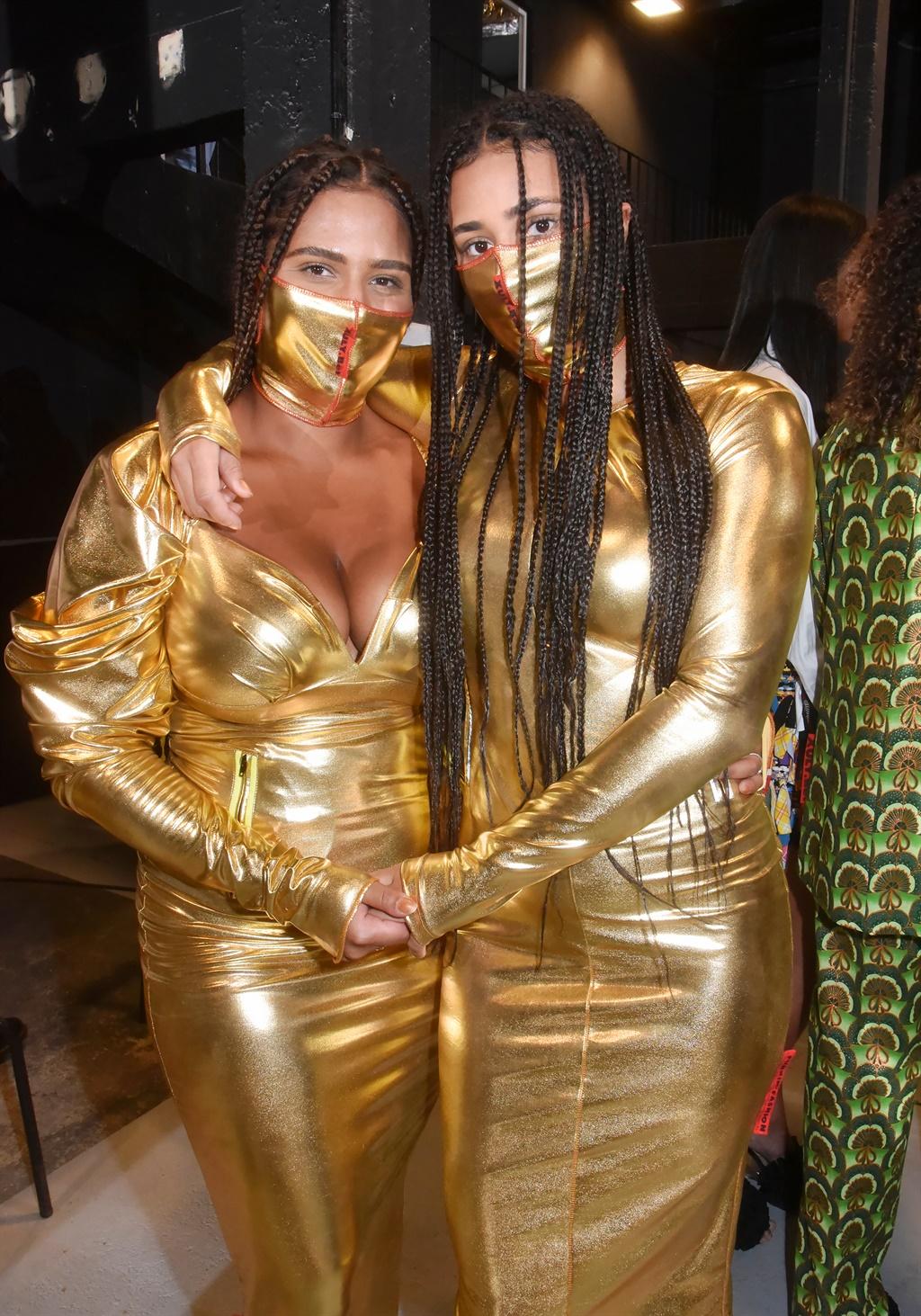 PARIS, FRANCE - OCTOBER 05: Models Naïma Dante an
