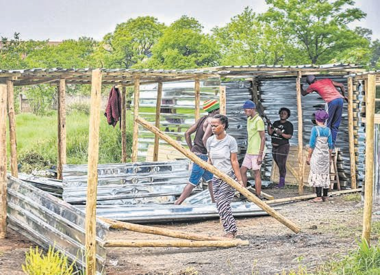The September shack fire victims busy rebuilding their homes at Jika Joe.