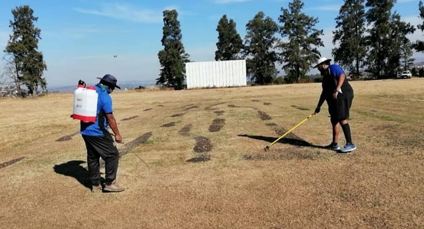 Members of the Protea Sports Park Association clean up the grounds last month.