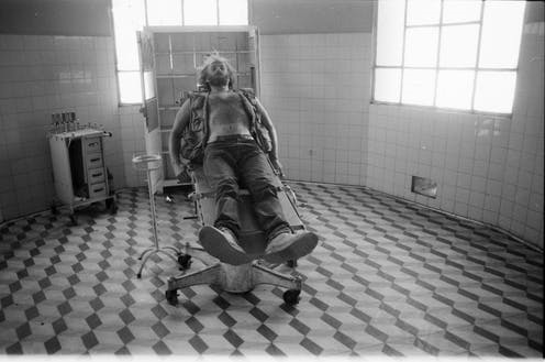 John Liebenberg in the ransacked hospital in Cubal, Angola, in 1993. (Photographer unknown/Courtesy the Liebenberg family)