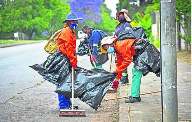 EPWP workers (front left) Nontsikelelo Mhlanzi, (front right) Nondumiso Zulu, (back left) Sizophila Phungula and Nontobeko Mthembu cleaning in Bulwer Street in Pietermaritzburg on Tuesday.