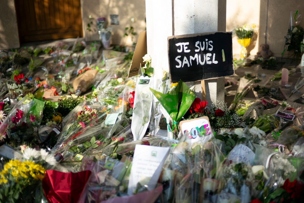 Flowers in front of the school where murdered school teacher Samuel Paty taught. (Photo by Aurelien Meunier/Getty Images)