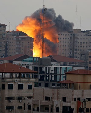 A ball of fire rises from an explosion on al-Zafar apartment tower following an Israeli air strike in Gaza City, in the northern Gaza Strip. (File, AP)