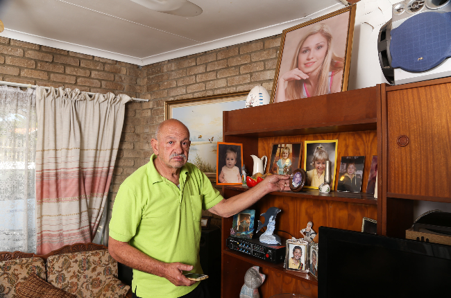 Dries Venter in his Rustenburg home which is adorned with photos of his Andrea and late wife Annetjie. (Photo: Lubabalo Lesolle)
