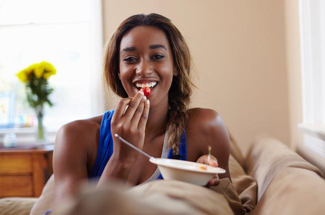 Woman enjoying fruit after exercise