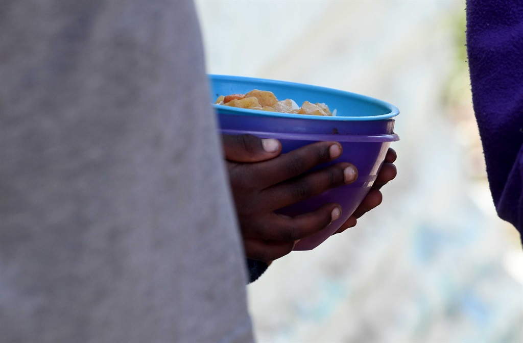 A child receives a meal
