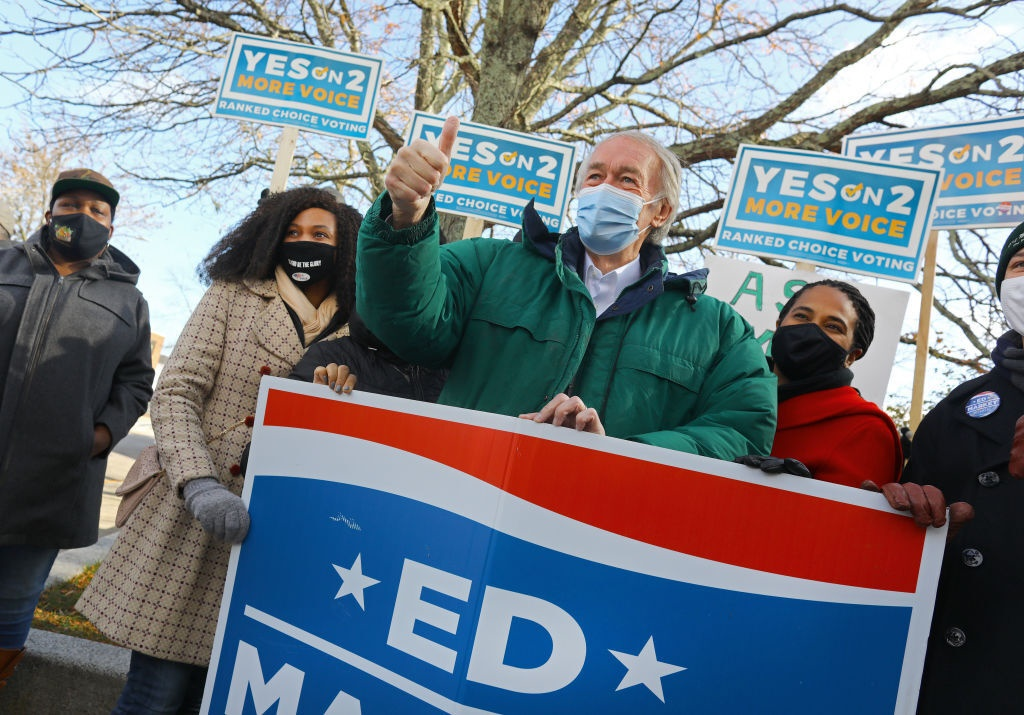 Senator Ed Markey poses with supporters outside t