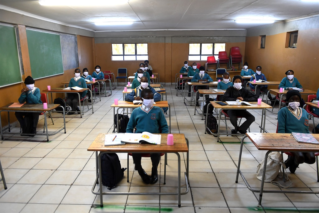 All learners and staff must follow the 1m physical distancing rule, be screened daily, and sanitise their hands before and after handling exam papers. Picture: Felix Dlangamandla