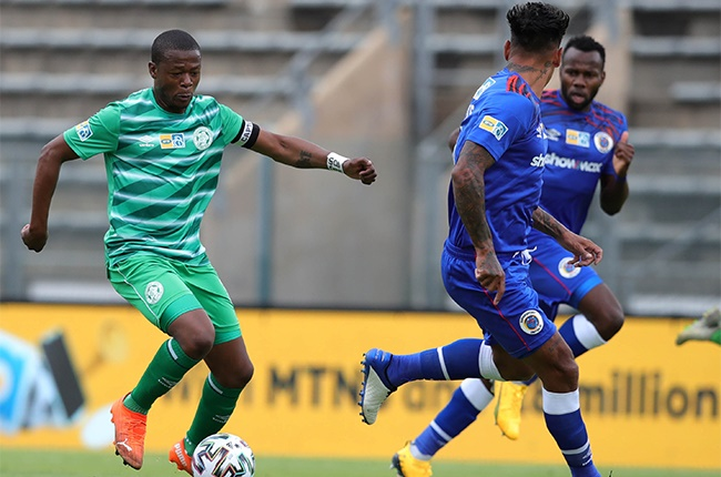 Ndumiso Mabena of Bloemfontein Celtic challenged by Clayton Daniels of Supersport United during the 1st Leg of the MTN8 Semi Final match between SuperSport United and Bloemfontein Celtic at Lucas Moripe Stadium on November 01, 2020 in Pretoria, South Africa.
