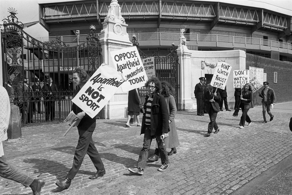 Supporters of the Anti-Apartheid 'Stop the Tour' movement parade with posters outside the Grace Gate at Lord's. (Photo by R. Taylor/PA Images via Getty Images)
