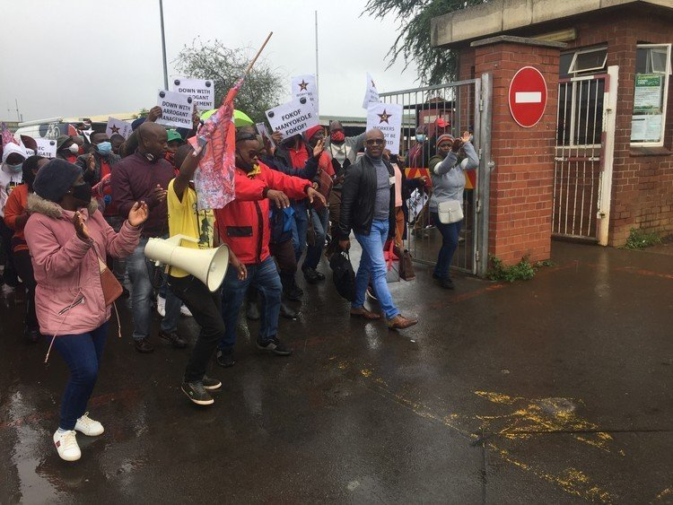 Nehawu members escorted Edward Manyokole (wearing a black jacket and blue jeans) from Northdale Hospital in Pietermaritzburg on Tuesday. The group are unhappy with how the new CEO is running the facility.
