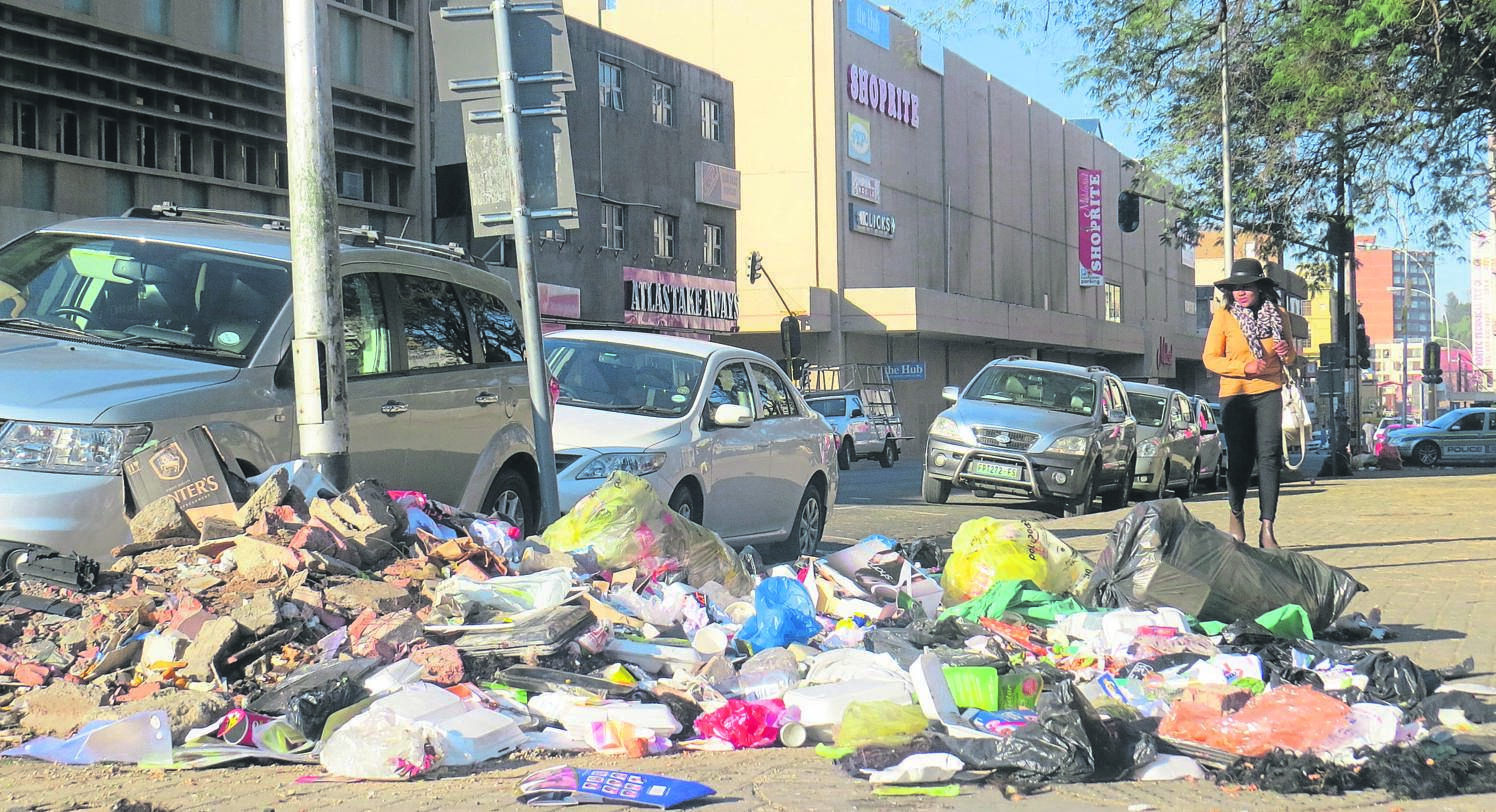 Tons of uncollected waste, which includes recyclable material that informal traders have disposed of, heap up along the streets of the Bloemfontein. The Mangaung Metro Municipality's collection problem continues unabated. Photo: Teboho Setena