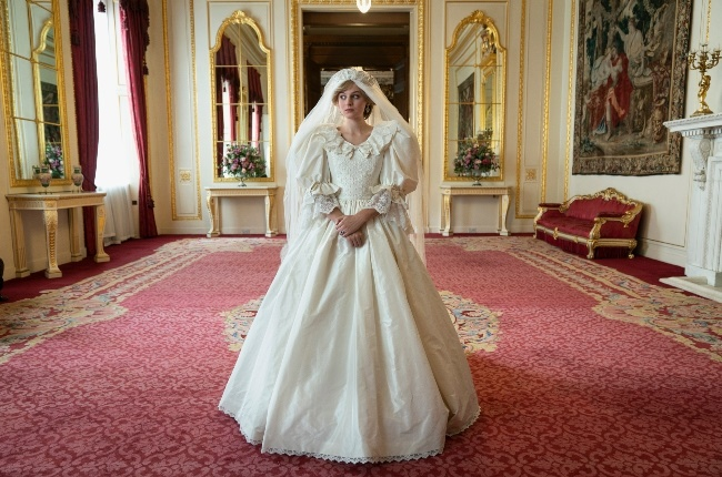 Emma Corrin, who plays Princess Diana in The Crown, in the replica of her wedding gown. (PHOTO: NETFLIX/THECROWN)