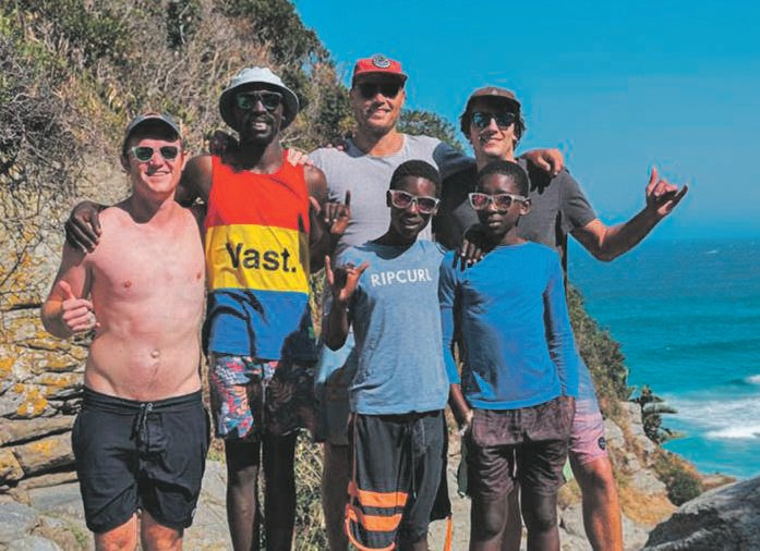 Filmmakers Kyle Smith (far left), Timothy Hay and Dylan Theron (far right) are pictured with the stars of Manzi Olwandle (Ocean Water), Avuyile 'Avo' Ndamase, Mphathi Ndlovu and Sanele Mthethwa.