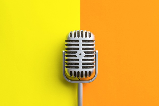 Flat lay of retro microphone on double colorful ba