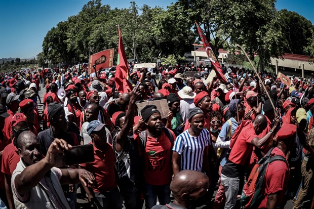 """<p>As the EFF continued to negotiate passage with police, EFF spokesperson Vuyani Pambo spoke to News24 and other media.</p><p>Pambo said: """"We are simply saying, we are all going to march, all of us to the school there. That is what we are going to do.&nbsp;</p><p>""""No one is going to stop us. We are going to go there nicely, peacefully. Anyone who comes at us we will go at them.</p><p>""""It's a protest. Where have you seen where people are protesting they are being told 'no, only 100'. There's no such thing. It's a protest - let's get it right.</p><p>""""As such, it cannot be regulated like a gathering of a party or people drinking.&nbsp;""""No, it's a protest that comes from a grievance.&nbsp;</p><p>""""Those things of only 100 (protesters) you will only hear from them. We are protesting. And a protest can't be told by those we are protesting against, how to protest.&nbsp;</p><p>""""They can't klap us and tell us we must smile now. We are not going to smile. We are going to return the klap.""""</p><p>Police on the scene had previously maintained that only 100 protesters would be allowed based on the agreement by the City of Cape Town.&nbsp;</p><p><em>(Photo:&nbsp;@EFFSouthAfrica, Twitter)</em></p>"""