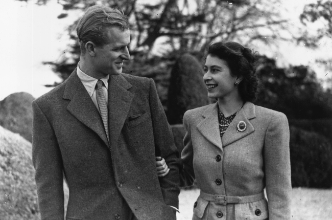 The couple enjoying a walk on honeymoon at Broadlands House in Hampshire in 1947, owned by Philip's uncle, Lord Mountbatten. (Photo: Gallo Images/Getty Images)