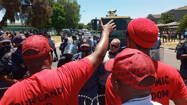 """<p>Here's a brief rundown of the day:</p><p><span style=""""font-size:0.75em;""""></span>Just after 10:00 this morning police fired stun grenades and water cannons at EFF supporters as they marched up a road headed toward Brackenfell High School.<span style=""""font-size:0.75em;""""></span><br /></p><p>Just before <strong>11:30</strong>, the EFF's secretary general <strong>Marshall Dlamini</strong> arrived, flanked by spokesperson <strong>Vuyani Pambo</strong>. </p><p>The bone of contention at this stage was due to the number [of protesters] exceeding the agreed upon number of 100 participants.</p><p>Said Pambo: """"It's a protest. Where have you seen where people are protesting they are being told 'no, only 100'. There's no such thing. It's a protest.""""</p><p><strong>Guillaume Smit</strong>, chairperson of the School Governing Body (SGB) told News24 matric pupils wrote their Physical Science paper in peace amid fears the vital final would be disrupted.</p><p>By <strong>16:00</strong> the EFF's supporters waited at pick up points around Brackenfell for their transport home.&nbsp;Police wound the barbed wire back in again, and armoured vehicles trundled back to their depot.&nbsp;</p><p>A block away from the school, ducks waddled across the road and a woman watered her garden, in contrast to the angry scenes nearby earlier.</p><p>- <em>Reports by Tammy Petersen and Jenni Evans </em>at Brackenfell on Friday.</p>"""