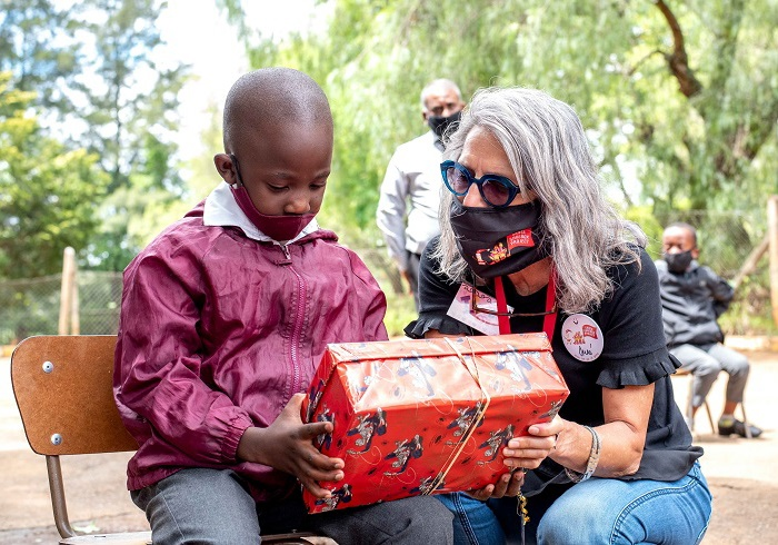 Lyanda from Pietermaritzburg was the recipient of the one millionth Book Dash book, seen here with Irene Steenkamp Pieters, the founder of the Santa Shoebox Project. (Image supplied/Giya Photography)