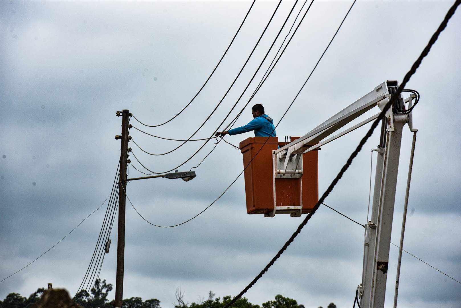Contractors remove illegal connections.
